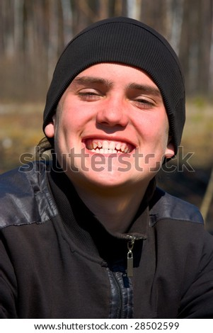 Portrait of a guy with pleased smile - stock photo