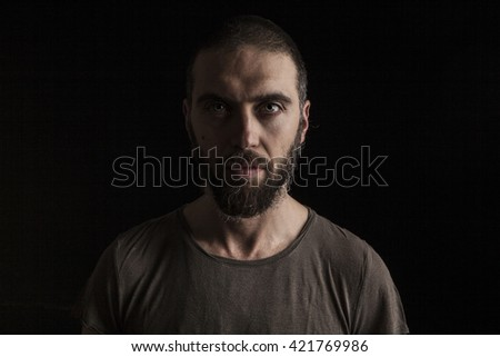 portrait of a handsome bearded man on dark background