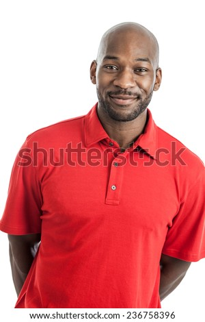 Portrait of a handsome black man in his 20s with arms behind back isolated on a white background - stock photo