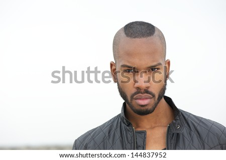 Portrait of a handsome black man looking at camera - stock photo