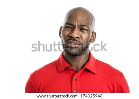 Portrait of a handsome black man with doubtful expression isolated on white background - stock photo