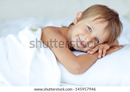 Portrait of a handsome boy awakened - stock photo