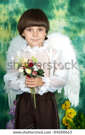 portrait of a handsome boy with angel wings