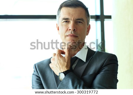 Portrait of a handsome business man - stock photo