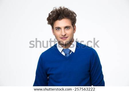 Portrait of a handsome business man standing over gray background - stock photo