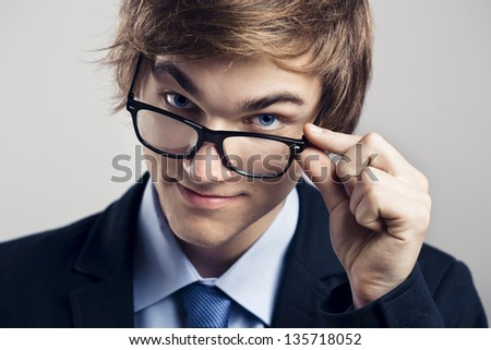 Portrait of a handsome business man wearing glasses - stock photo