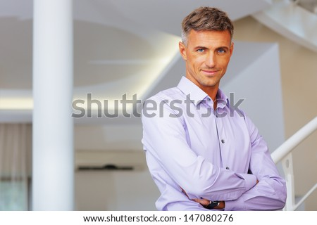 Portrait of a handsome confident man - stock photo