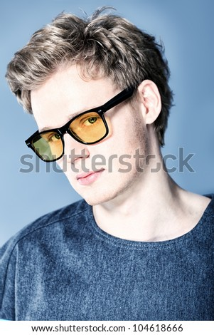 Portrait of a handsome fashionable man posing at studio. - stock photo