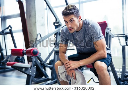 Portrait of a handsome fitness man resting at gym  - stock photo
