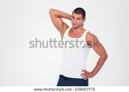 Portrait of a handsome fitness man standing isolated on a white background