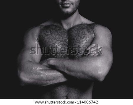 Portrait of a handsome guy with crossed hands. Black and white - stock photo