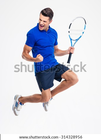 Portrait of a handsome male tennis player celebrating his success isolated on a white background