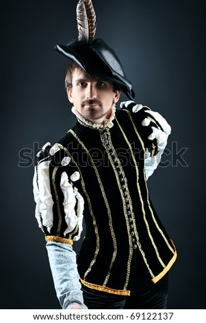 Portrait of a handsome man grandee in 16th century costume. Shot in a studio. - stock photo