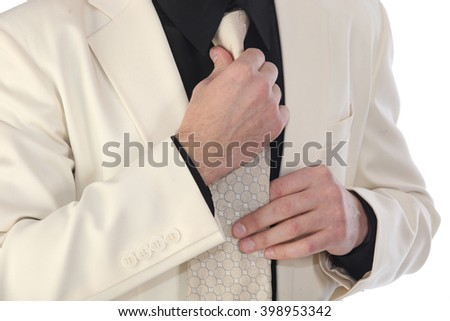 portrait of a handsome man in a white suit and a black shirt on a white background studio
