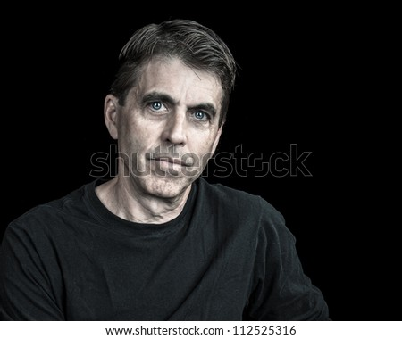 Portrait of a handsome man on black background.