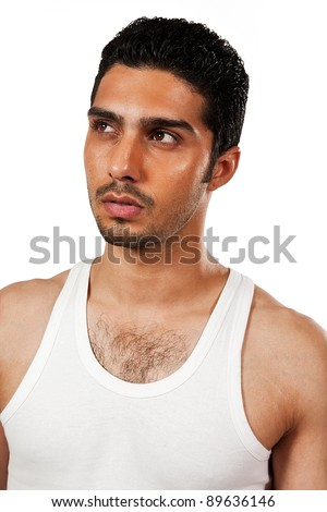 portrait of a handsome man wearing vest, Indian man with a muscular body - stock photo