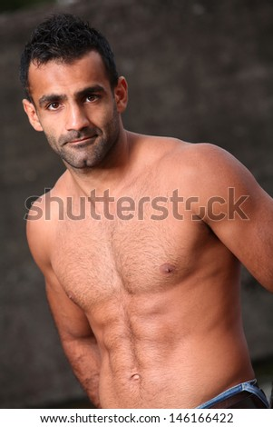Portrait of a handsome man who is posing shirtless