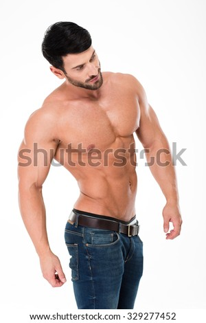 Portrait of a handsome man with muscular body posing isolated on a white background and looking away  - stock photo
