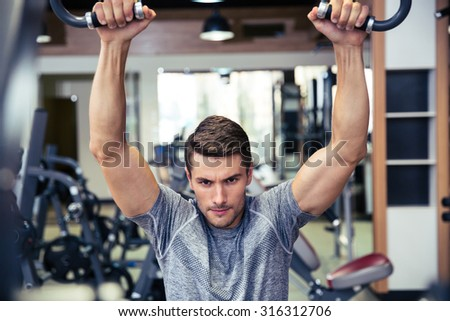 Portrait of a handsome man workout in fitness gym  - stock photo