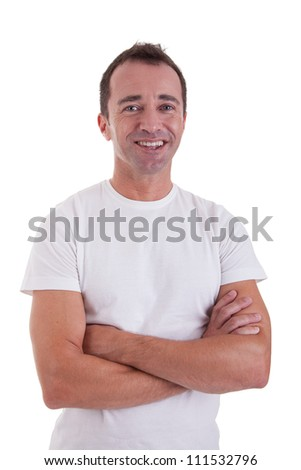 Portrait of a handsome middle-age man smiling, with arms crossed on white background. Studio shot - stock photo