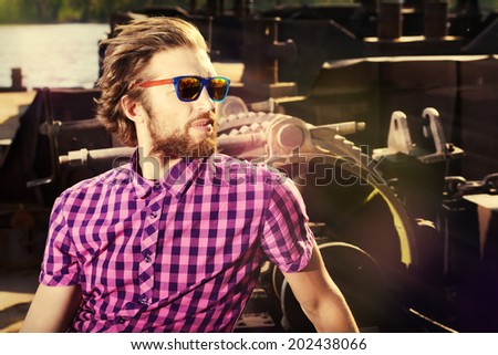 Portrait of a handsome modern young man outdoor. Fashion.  - stock photo