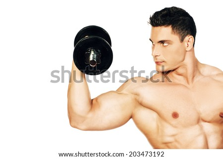 Portrait of a handsome muscular bodybuilder posing with dumbbell. Isolated over white background. - stock photo