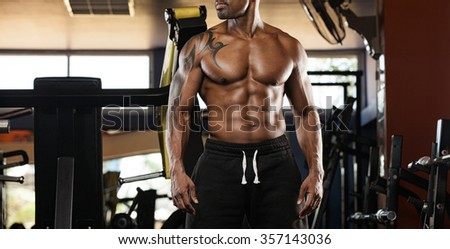 Portrait of a handsome muscular bodybuilder with muscular torso - stock photo