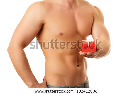 Portrait of a handsome muscular young man holding a present. - stock photo