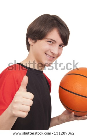 Portrait of a handsome smiling basketball player showing thumb up on white background