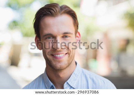 Portrait of a handsome smiling man looking at the camera - stock photo