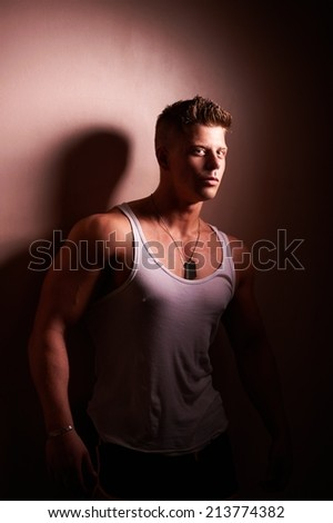 Portrait of a handsome strong bodybuilder posing