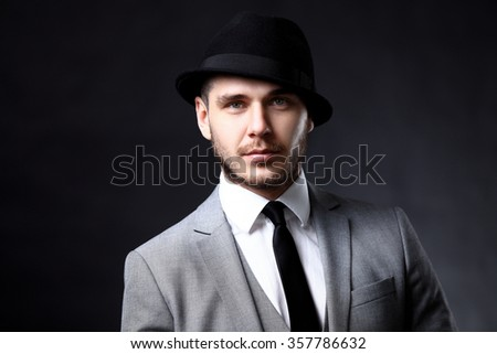 Portrait of a handsome stylish man in elegant suit