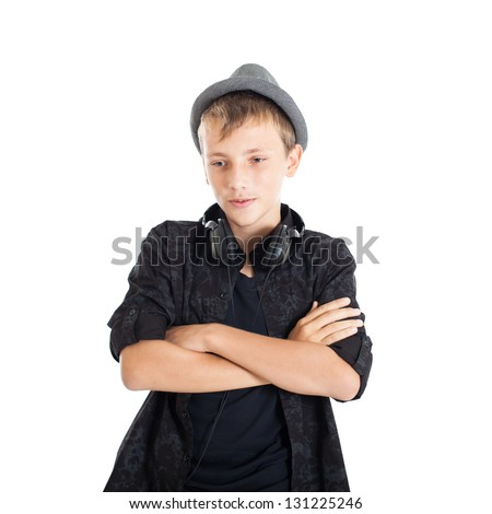 Portrait of a Handsome teen boy wearing a European black shirt and hat. The boy crossed his arms over his chest. Studio shot, isolated on white background. - stock photo