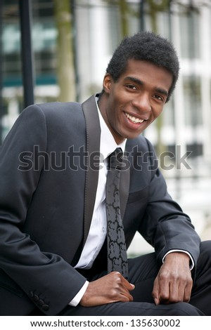 Portrait of a handsome young african american businessman smiling