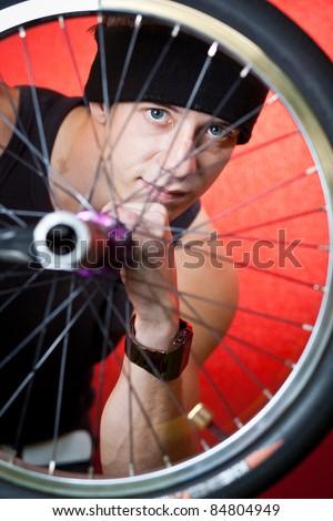 Portrait of a handsome young BMX biker - stock photo