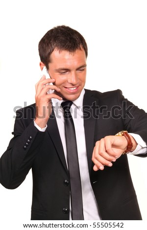 Portrait of a handsome young business man on cell phone - stock photo