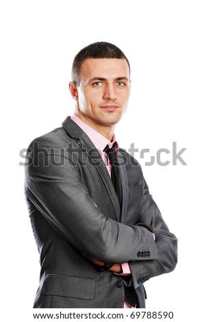 Portrait of a handsome young businessman in suit over white background - stock photo