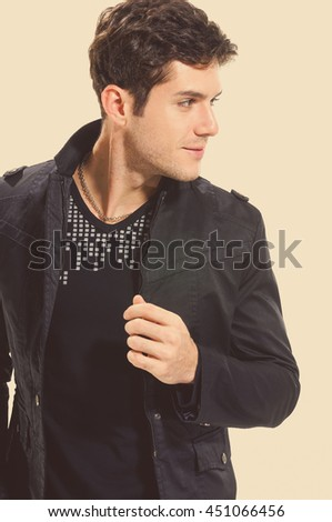 Portrait of a handsome young male - stock photo