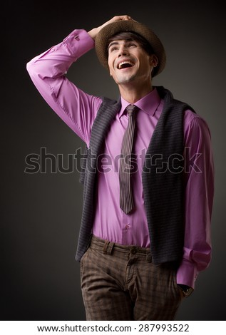 portrait of a handsome young male model laughing - studio shoot - stock photo