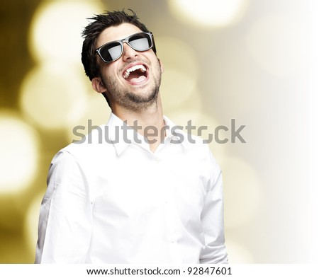 portrait of a handsome young man enjoying against a abstract background - stock photo