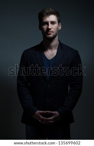 Portrait of a handsome young man in a dress - stock photo