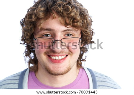 portrait of a handsome young man in glasses with curly hair