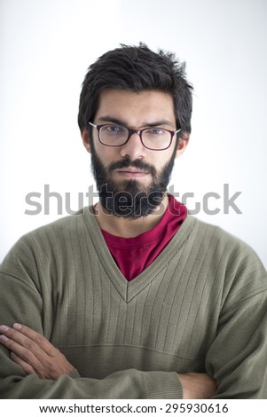 Portrait of a handsome young man in white background