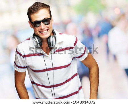 Portrait Of A Handsome Young Man Listening To Music, Outdoor
