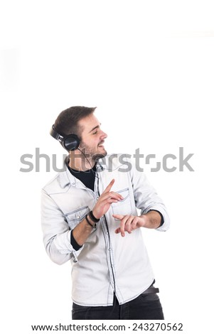 Portrait of a handsome young man listening to music with headphones - stock photo