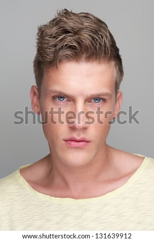Portrait of a handsome young man looking at camera - stock photo