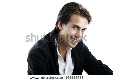 Portrait of a handsome young man smiling - stock photo
