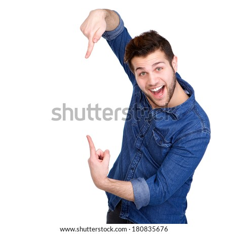 Portrait of a handsome young man smiling and pointing fingers showing copy space - stock photo