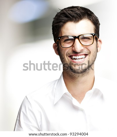 portrait of a handsome young man smiling indoor - stock photo