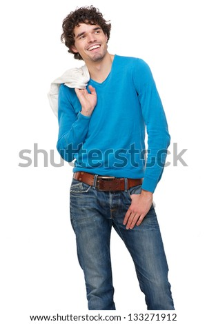 Portrait of a handsome young man smiling with jacket over shoulder - stock photo
